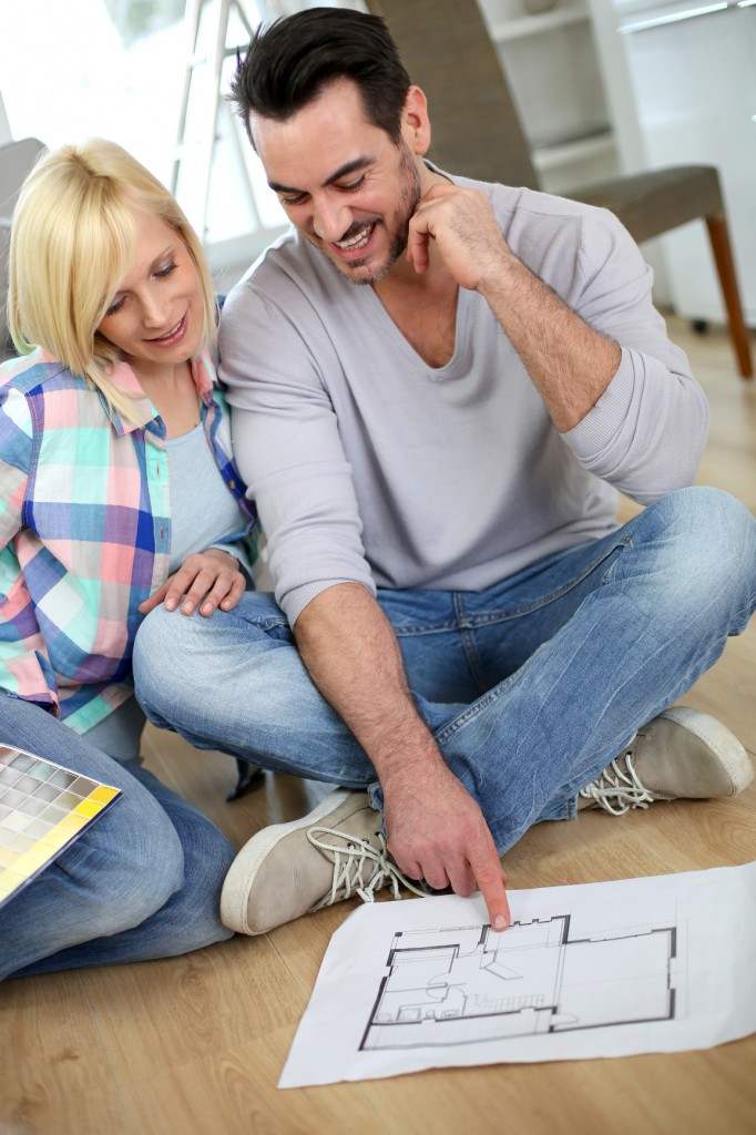 Couple Looking at Renovation Plans